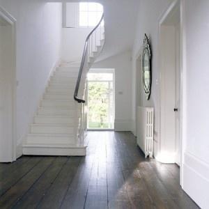 Hallway, dark floor, white stairs, white walls