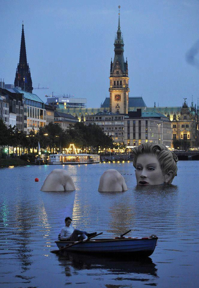 Badenixe Hamburg - Giant Mermaid Statue in Alster Lake Hamburg Germany  -  a 12-foot tall floating statue created by Oliver Voss and put in place in 2011.  Kind of creepy...but interesting idea!
