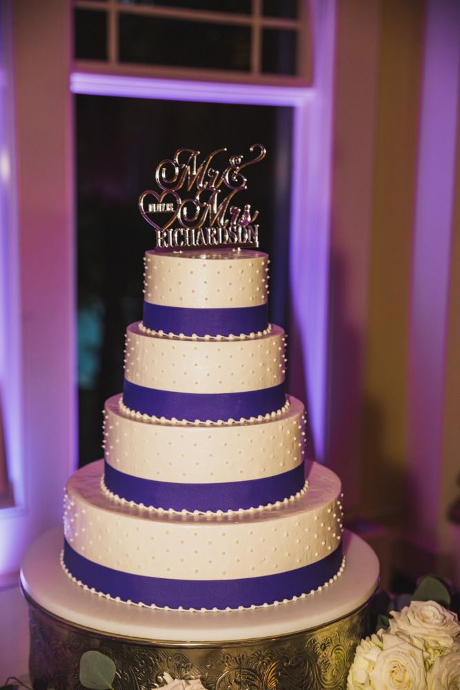 Wedding Cake Decorated With Buttercream And Purple Ribbon