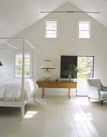 Master bedrm.  from House Beautiful - Water Color. Love all white interior, touch of wood. Rug Dash and Albert