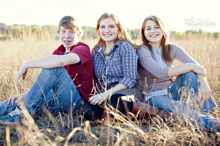 Posing adult siblings