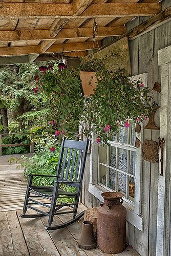 What a sweet front porch! I love the rocker and rustic look.