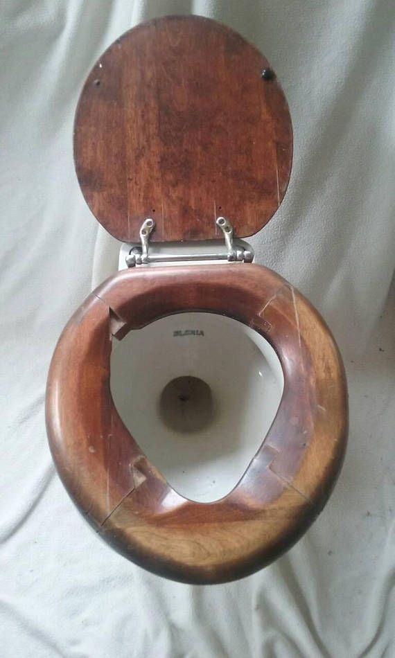 The Original Gloria Toilet, created by John Douglas Ridenour, owner of the John Douglas Plumbing Company, Cincinnati OH. Now closed. manufacturers of the Gloria toilet. Douglas, the son of Charles E. Ridenour, first plumber in Springfield, Ohio and owner/proprietor of the Charles