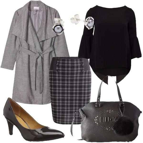 Non bisogna necessariamente dare nell'occhio per essere vestite bene. Questo ne è sicuramente l'esempio. Un bel cappotto grigio, disponibile in tutte le taglie, abbinato ad una blusa nera, alla gonna a quadretti, da indossare preferibilmente con un paio di calze nere, coprenti, ad un paio di décolleté in vera pelle, con tacco a cono, alla borsa grigia con pon pon nero e infine, al bel paio di orecchini a lobo in argento.