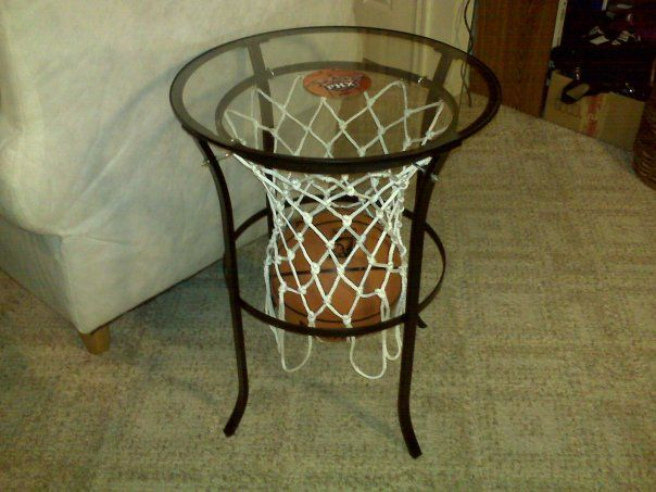 Materials: Ikea table, small hooks, long skinny hooks, basketball net, magnet of your favorite team, super glue, black spray paint, a saw to cut off the flowery part, rubber feet to make it into a trivet(optional) Description: My boyfriend loves basketball and I saw this other table at the NBA Store in NYC and decided [&hellip