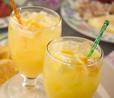 Easter Brunch Punch ~ ginger ale with a fruity blend of orange, lemon, peach, & pineapple juice ~ non-alcoholic drink recipe | via Mr. Food Test Kitchen