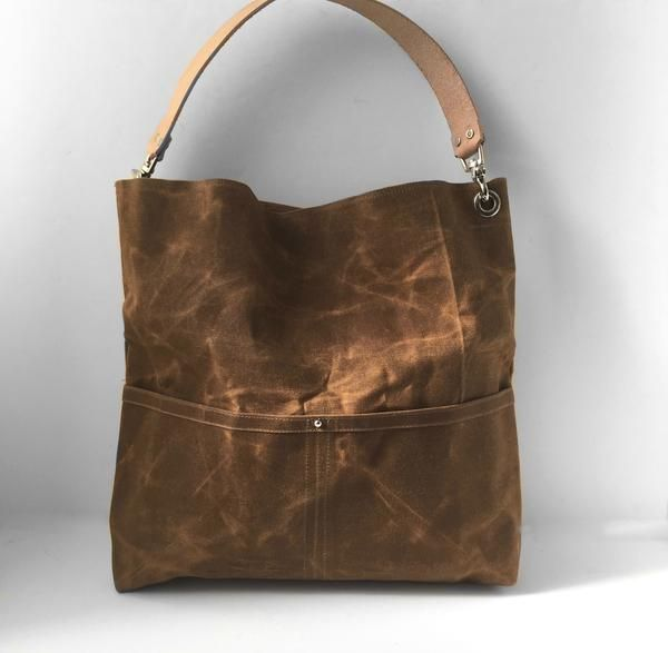 Our waxed canvas bucket bag is durable, lightweight and a breeze to carry. This rugged, natural canvas bag in Saddle Brown ages beautifully and looks better with a little wear and tear; becoming softe
