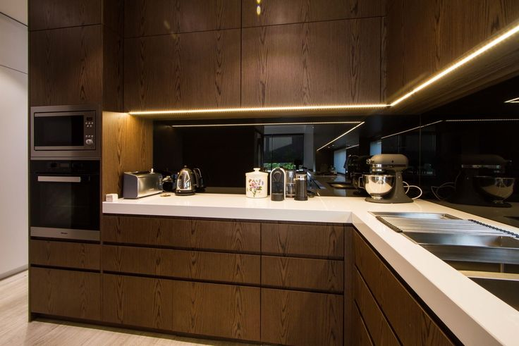 Modern veneer, handless kitchen with a butlers pantry to die for. www.thekitchendesigncentre.com.au @thekitchen_designcentre