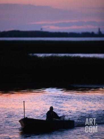 Fisherman in Boat Heading Back to Dock Near Tisza Lake (Tisza To), Tiszafured, Hungary Photographic Print by David Greedy at Art.com