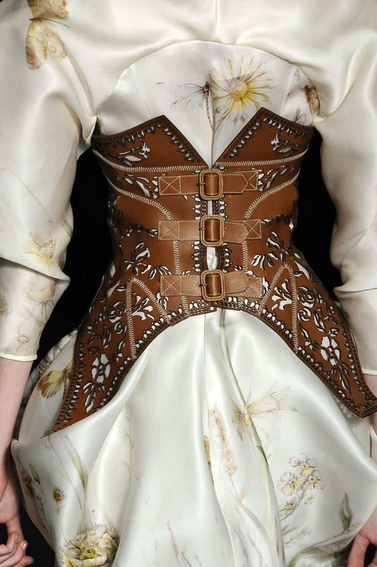 leather corset // Alexander McQueen. I'm no fan of constraint but this is beautiful.