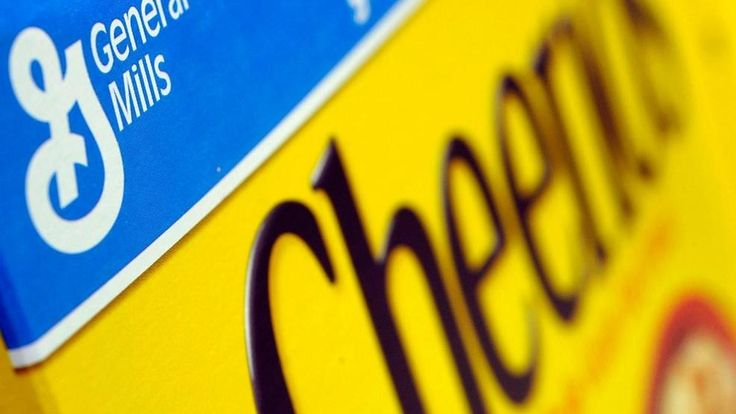 FILE – In this Dec. 15, 2007 file photo, a box of General Mills' Cheerios is seen on a shelf at a Shaw's Supermarket in Gloucester, Mass.  General Mills says it will start labeling products across the country that contain genetically modified ingredients to comply with a...