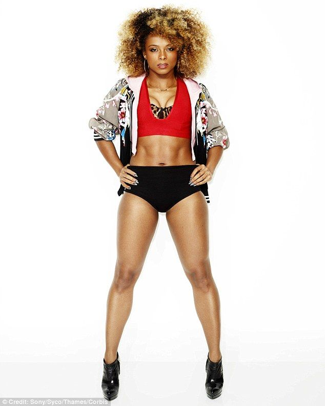 Diva in the making: Fleur East looked every inch the pop star in a new X Factor publicity photograph as she displayed her abs in a bra top