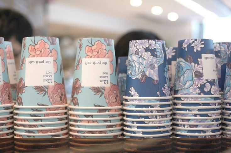 Le Petite Cafe, Hong Kong - floral graphics on takeaway cups    use a recognizable cup - marketing