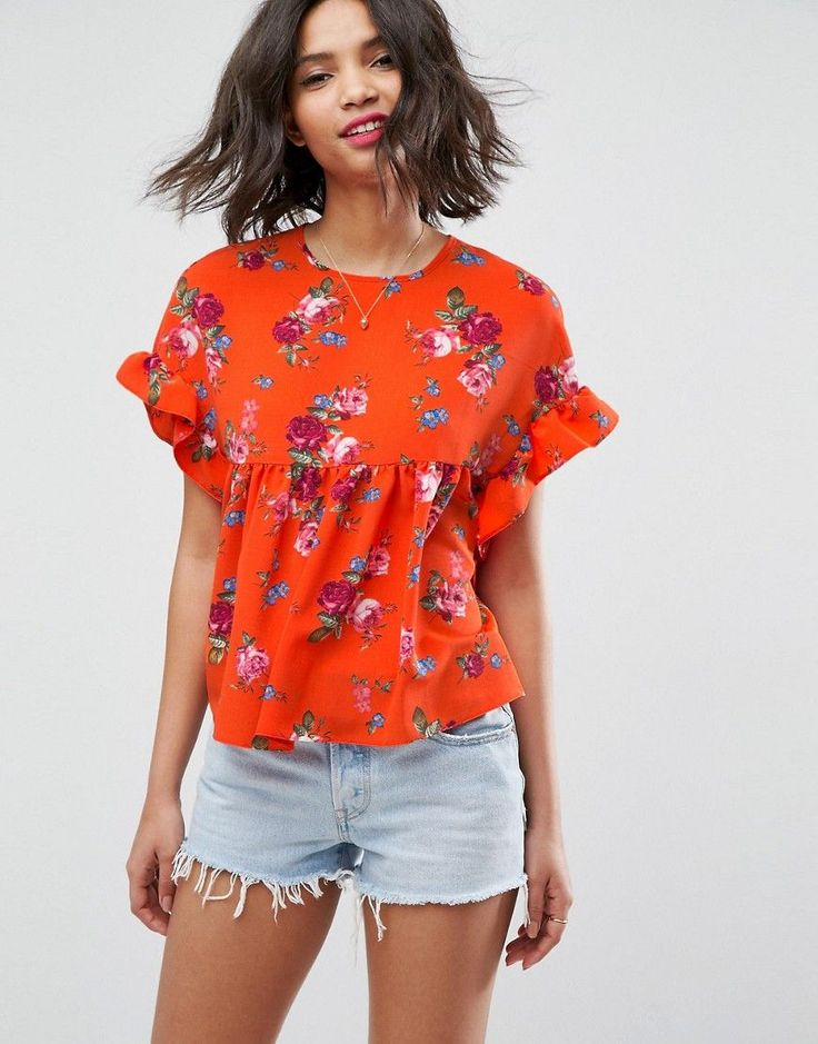 Buy it now. ASOS Smock Top with Ruffle Sleeve in Orange Floral - Multi. Top by ASOS Collection, Lightweight woven fabric, Floral print, Round neck, Ruffle sleeves, Smock shape, Button-keyhole back, Loose fit � falls loosely over the body, Machine wash, 100% Polyester, Our model wears a UK 8/EU 36/US 4 and is 179cm/5'10.5 tall. Score a wardrobe win no matter the dress code with our ASOS Collection own-label collection. From polished prom to the after party, our London-based design team…