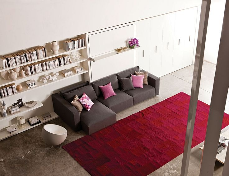 Contemporary murphy bed with a large L-shaped Sofa