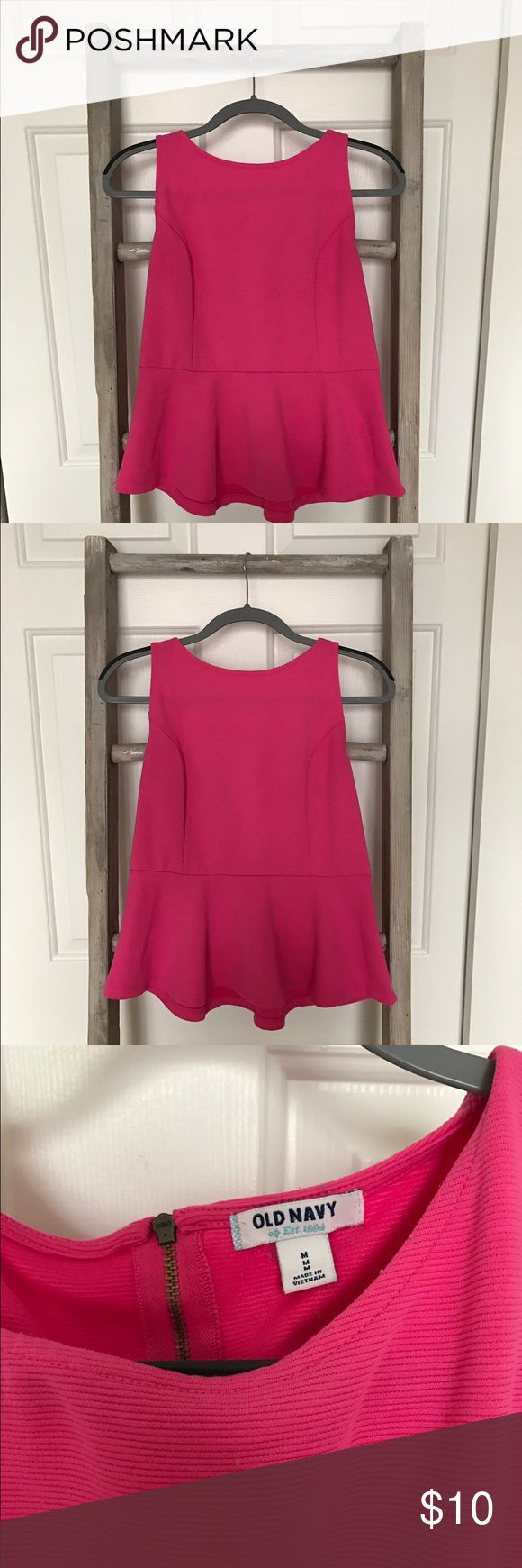 Pink Peplum Top | size medium This peplum is the perfect top to wear to the office or your next girls night out. It has a structured fit, with a half zipper in the back. Fits TTS! Old Navy Tops Blouses