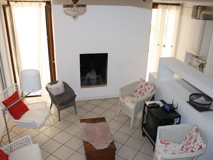Gargnano house rental - 1st floor: room with fireplace + 5 chairs, sofa, bench, TV
