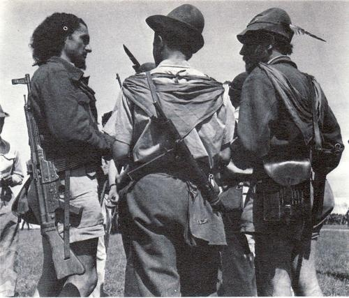 .Italian partisans.Location and date unknown.WW 2.The one on the left packs the new and powerful German StG 44 (Sturmgewehr 44) assault rifle, surely a bellic prey.