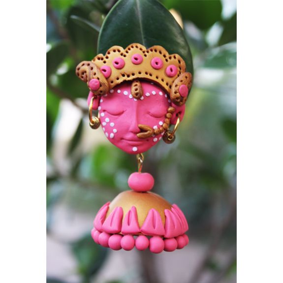 The possibilities of creative ideas are endless when it comes to Polymer Clay and we present to you, our collection of skillfully crafted ethnic jewelry designs, which are inspired by divinity Care - Store in zip lock pouches and clean with soft cotton when required  Dimension - L 7cms ; Stud size 5cms; Base 4cms; weight 30gms (15 gms each); Colour - Pink + gold Material - Polymer ; Finish - Handcrafted ; Closure - Post