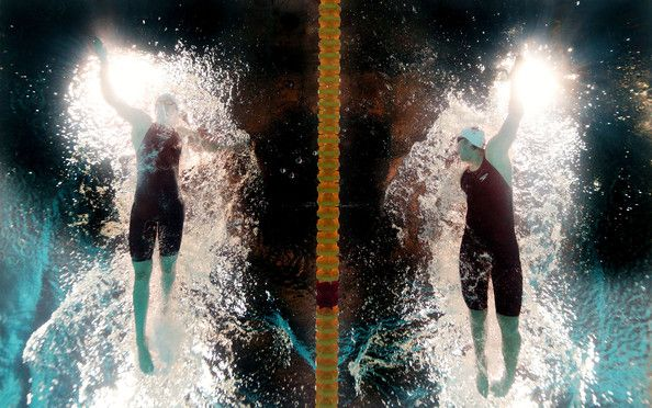 (L-R) Hannah Miley of Great Britain and Shiwen Yi of China compete during the Swimming Women's 400m Individual Medley Heat 4 on day sixteen of the 15th FINA World Championships at Palau Sant Jordi  on August 4, 2013 in Barcelona, Spain.