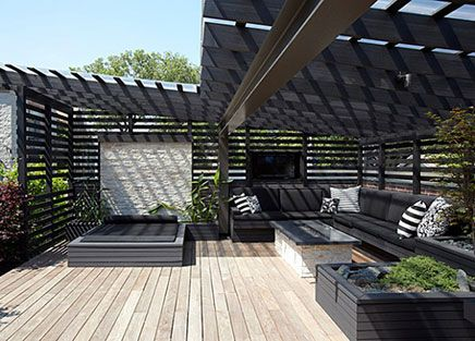 Pitched timber pergola in black with Makrolon (or similar) roofing over. Pinned to Garden Design - Pergolas by Darin Bradbury.