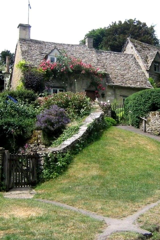 Cotswold cottage | Bibury, England. Colorful flowers, stone wall, cute gate.                                                                                                                                                     More