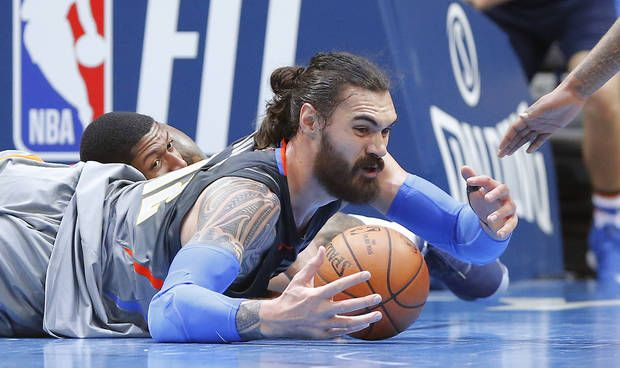 Oklahoma City's Steven Adams (12) reaches for the ball in front of Washington's Bradley Beal (3) during an NBA basketball game between the Oklahoma City Thunder and the Washington Wizards in at Chesapeake Energy Arena in Oklahoma City, Thursday, Jan. 25, 2018. Photo by Bryan Terry, The Oklahoman