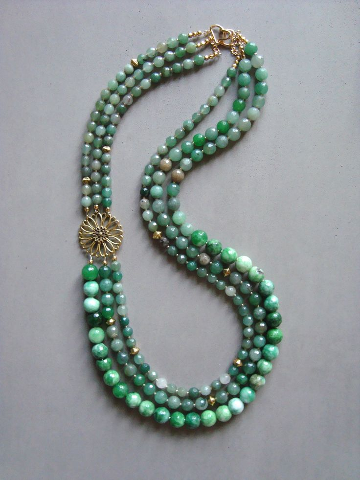 V I R E N T I — Triple Strand Jade & Agate Necklace with a gold tone accent flower. Hook clasp. 31 inches long. — $98.00