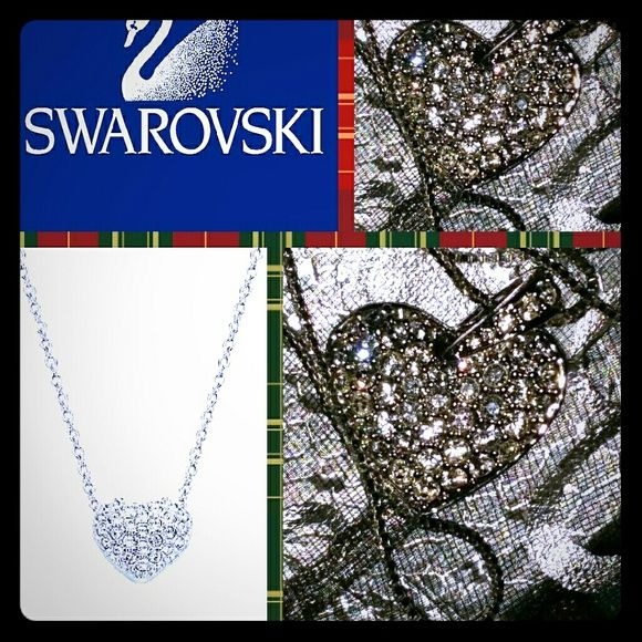 SWAROVSKI HEART SWAROVSKI CRYSTAL PUFFED HEART PENDANT WITH CHAIN...IF ARNT LUCKY ENOUGH TO HAVE PARENTS WHO SHOWER YOU WITH DIAMONDS EVERY CHANCE THEY GET (BECAUSE THEY GAVE UP ON FINDING ME A GUY TO SHOWER ME WITH DIAMONDS), A SWAROVSKI CRYSTAL HEART PENDANT IS A GOOD ENOUGH SUBSTITUE LADIES ITS TRE GORG!?? THE PHOTOS ARE MINE I TOOK THEM OF MY NECKLACE!  :) Swarovski Jewelry