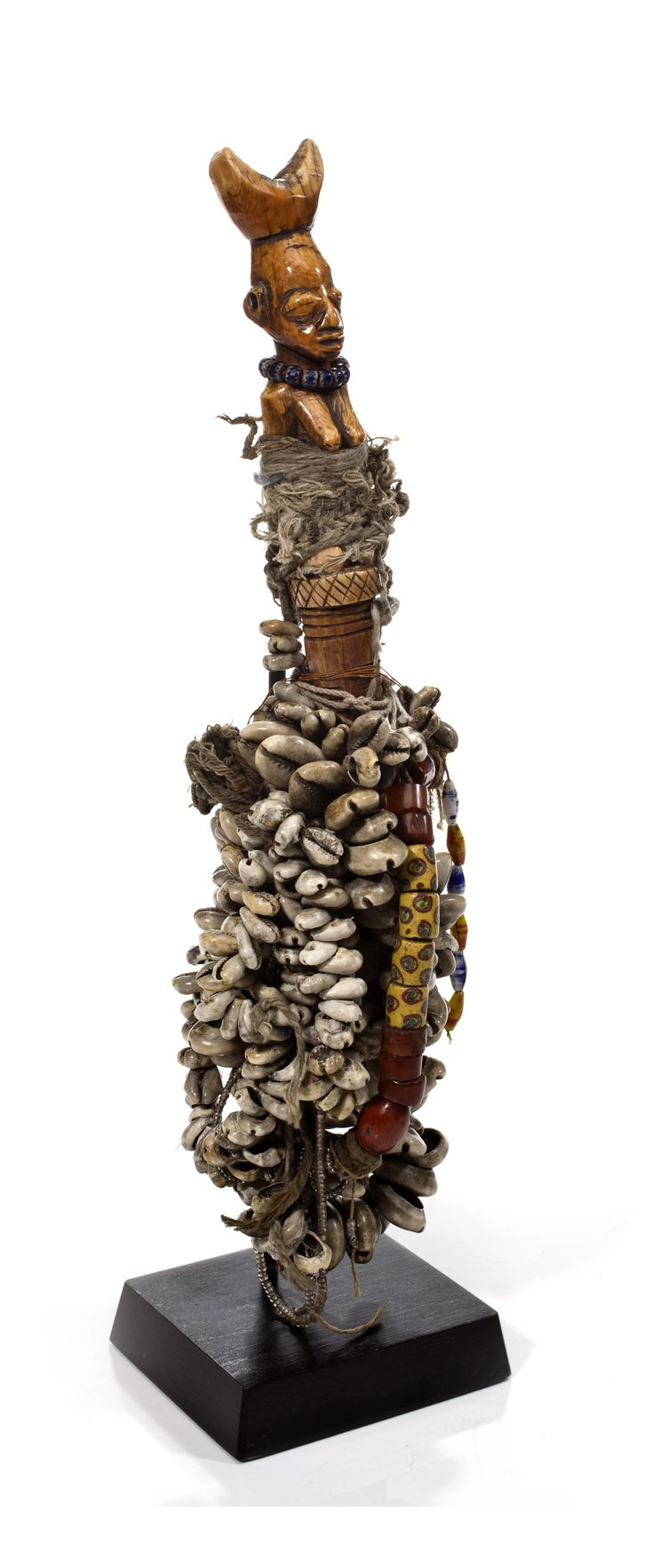 Africa | Whistle from the Yoruba people of Nigeria | Ivory, decorated with fiber, glass beads and cowrie shells