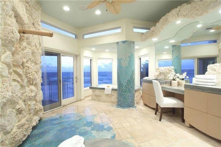 Coastal themed luxury master bathroom design idea with coral walls and seafoam blue pillar. 50 Magnificent Luxury Master Bathroom Ideas ➤To see more Luxury Bathroom ideas visit us at www.luxurybathrooms.eu #luxurybathrooms #homedecorideas #bathroomideas @BathroomsLuxury