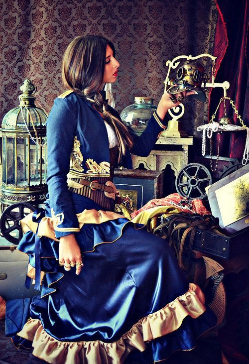 Blue and Gold Steampunk Style (military style bolero jacket, underbust corset, tiered ruffle skirt, belt) - For costume tutorials, clothing guide, fashion inspiration photo gallery, calendar of Steampunk events, & more, visit SteampunkFashionGuide.com