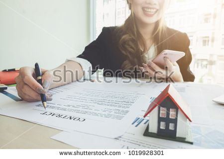 Close up of Business woman smiling and pointing and signing