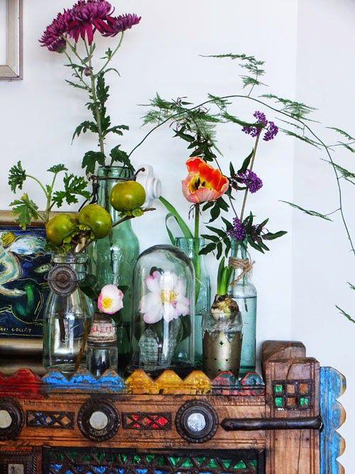 flowers and vintage bottles via small acorns blog