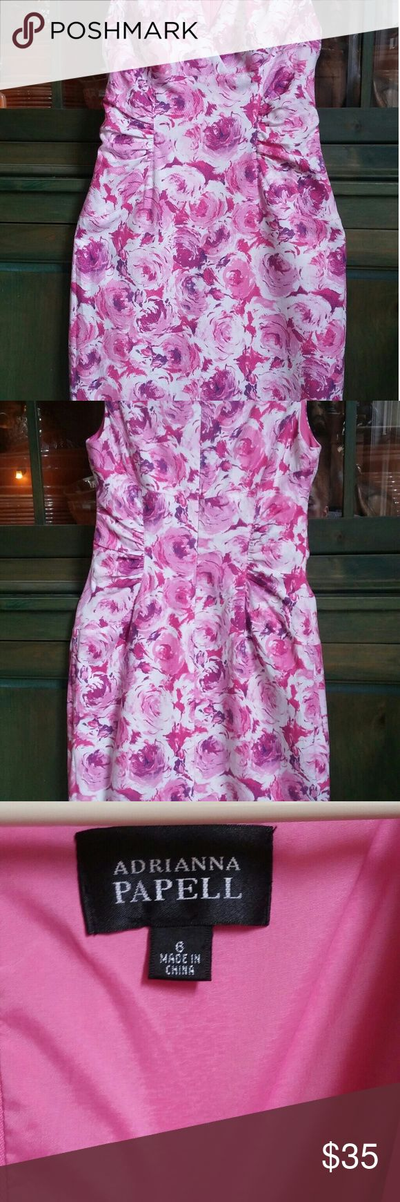 "Adrianna Papell Spring Summer Dress Adrianna Pappell spring or summer wedding guest dress. Figure flattering. Slim fit. I am 5' 6"", 134 lbs and it fit perfect with no room left. Colors are pinks with some slashes of purple. Falls below the knee. Dress is in good condition. I bought it used, wore once. It is clean with no rips or worn areas. Size 6. Adrianna Papell Dresses Wedding"