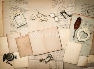 Old letters and photo frames. Vintage things, handwritten docume