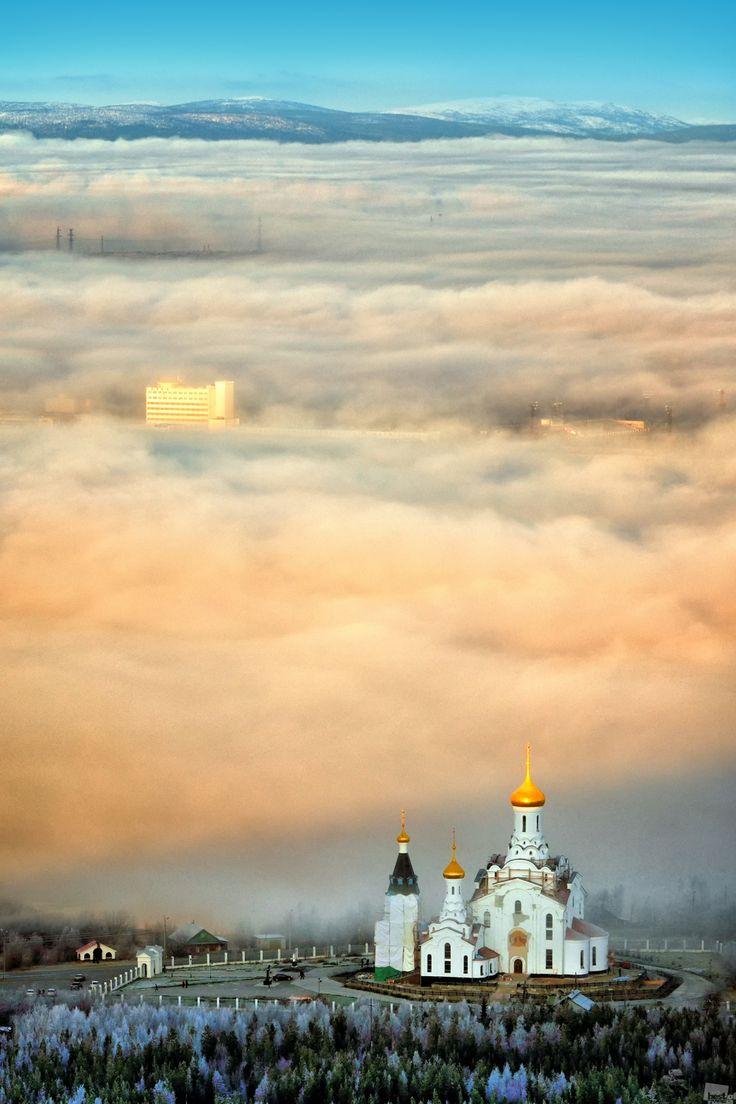 Early-autumn fogs on the Kola Peninsula. Svyato-Voznesensky Cathedral, Monchegorsk, Murmansk Region Russia