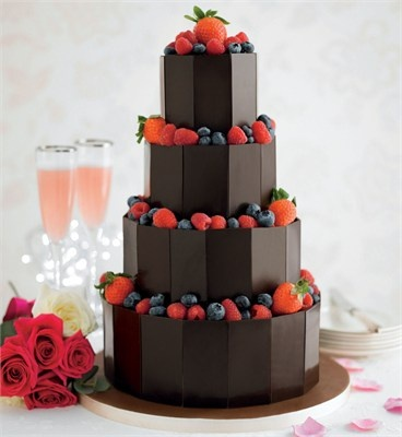 "Chocolate and berries... how could you go wrong. This cake looks built with chocolate bars gives a nice ""architectural"" feel, while the berries give it a casual look."