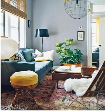 bright room, teal couch, yellow ottoman, floor lamp, plant #pastels