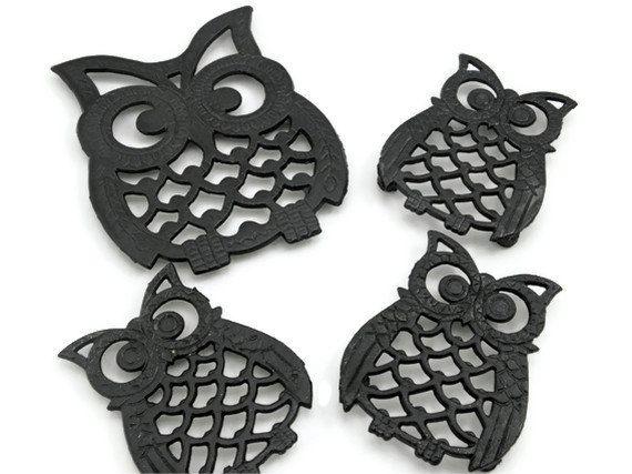 Vintage Trivets Wrought Iron Metal Owls Set of Four Black Kitchen Decor. $15.00, via Etsy.