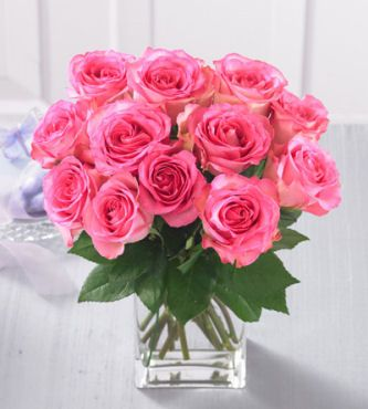 Roses - Dozen Medium Pink Roses in Vase - FedEx - One dozen beautiful medium-stem Pink Roses (40 cm), this elegant pink rose bouquet is the perfect gift to send any time of the year.  They arrive wrapped with greens and a classic glass vase, ready for the recipient to arrange in their own special way.