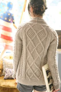 free pattern - I love the shape of the back, how the shoulders slide out of the neck, the eye drawn down by the cabling - but will I ever be up for quite so much pattern?