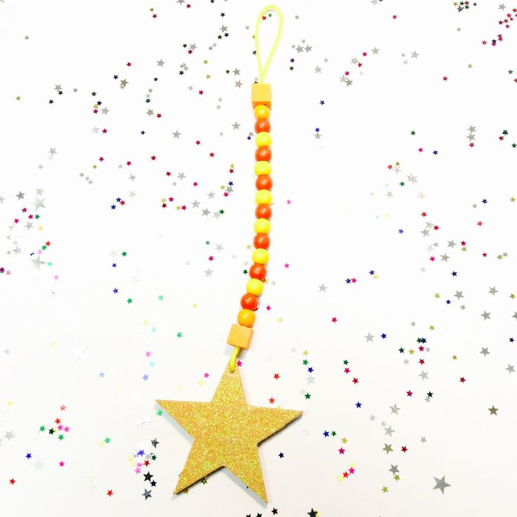 A personal favourite from my Etsy shop https://www.etsy.com/au/listing/470324930/wooden-bead-garland-glitter-star-drop