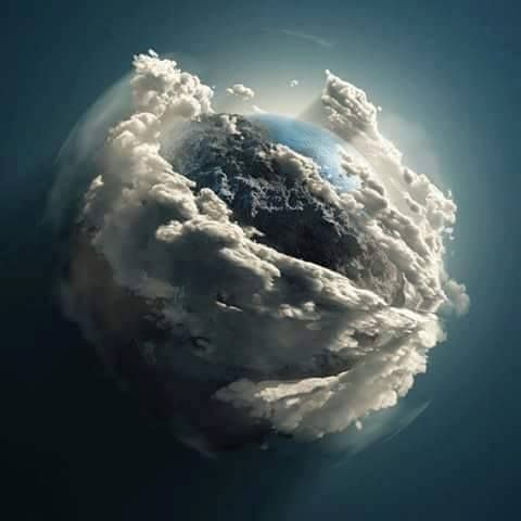 The earth cradled by clouds, from the Hubble telescope
