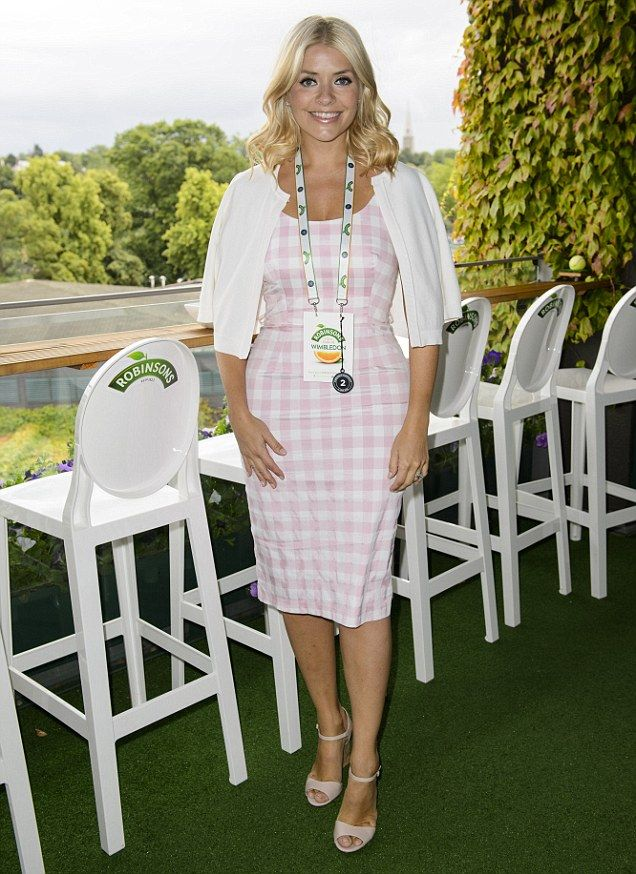 Checking it out! Holly Willoughby watched the tennis in a pretty checkered dress that she wore in shades of pink and white