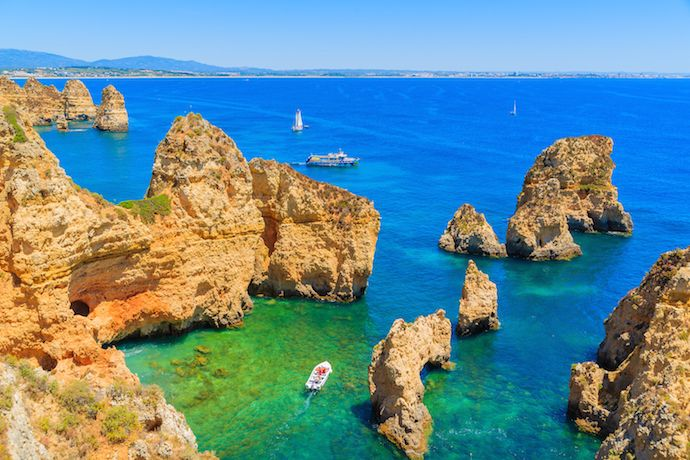 Fishing boat on turquoise sea water in Portugal