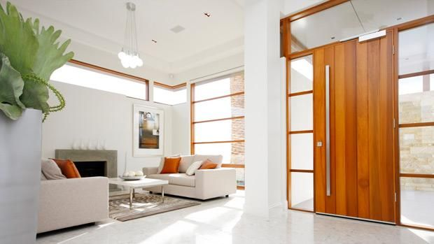 A bold front door with oversized handle & an abundance of natural light make this a stunning entrance for any home...