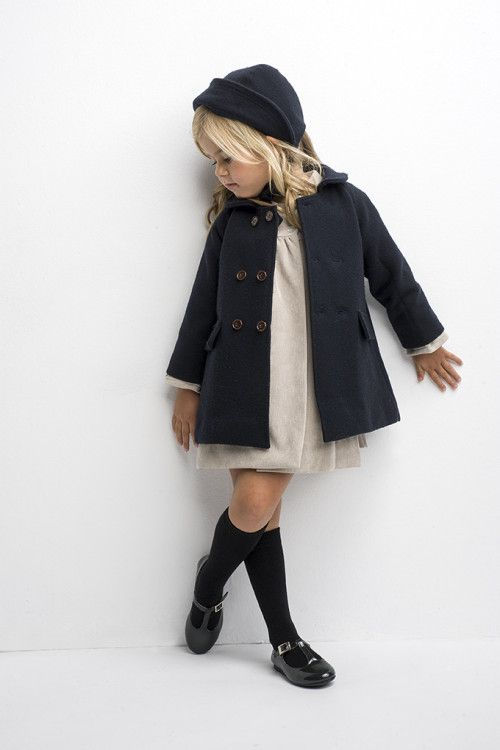 Knee high socks and very dark colours with light dress @Little_Moppets #StylishLittleMoppets