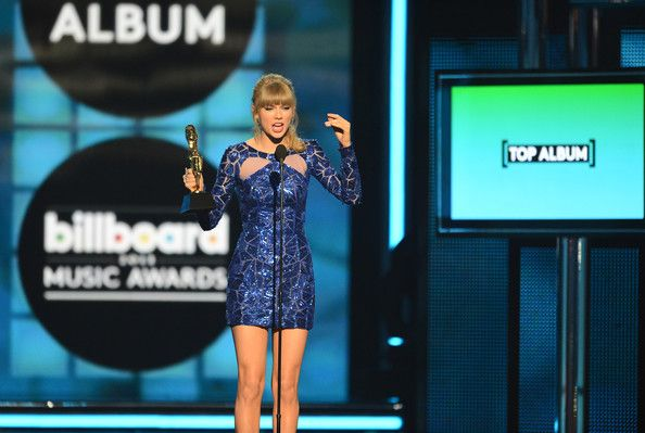 "Taylor Swift Photos Photos - Singer Taylor Swift accepts the award for ""Top Billboard 200 Album"" onstage during the 2013 Billboard Music Awards at the MGM Grand Garden Arena on May 19, 2013 in Las Vegas, Nevada. - Inside the Billboard Music Awards"