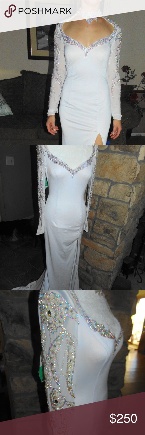 """Panoply White Crystal Pageant Prom Gown 4 6 Long sheer flame design beaded and AB rhinestone sleeves and collar, open sweetheart neckline, matte jersey trumpet gown with low back, high side front slit and train. Jersey. Worn once for a photo shoot. Will need to be drycleaned. Has tags with it . 2nd to last pic shows it on with 6"""" heels. My daughter is 5'7"""" so it is about an inch too short with tippy tops. Because it is jersey material can fit 4 6 and 8 or be altered smaller Panoply Dresses…"""